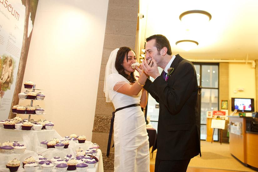 Maidu Indian Museum Roseville wedding photos, a couple eating wedding cake