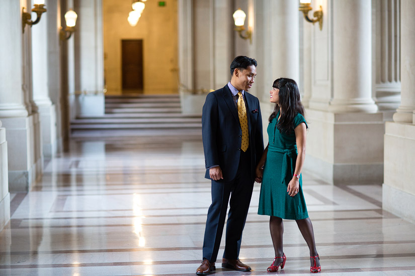 san francisco city hall engagement photo of puja holding john's hand