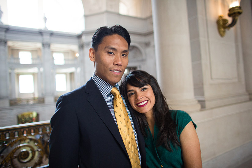 san francisco city hall engagement photo of puja hugging john