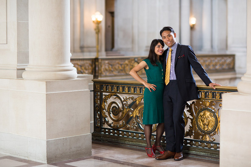 san francisco city hall engagement photo of puja & john standing