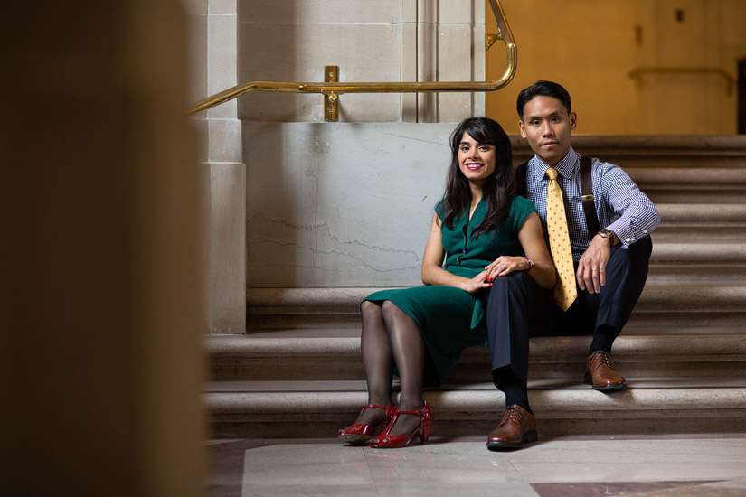 san francisco city hall engagement photo of puja & john sitting