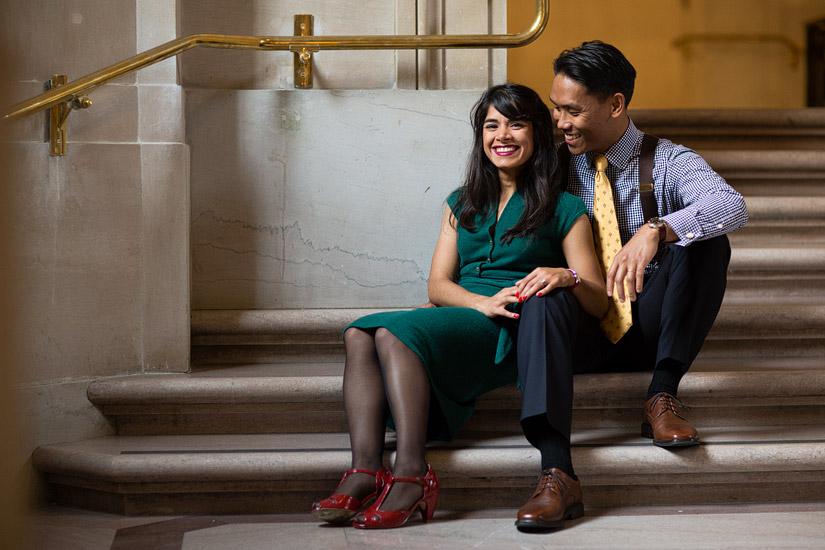 san francisco city hall engagement photo of puja & john sitting