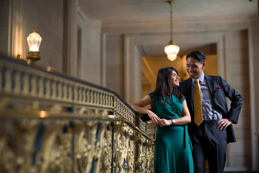 san francisco city hall engagement photo of puja & john hugging