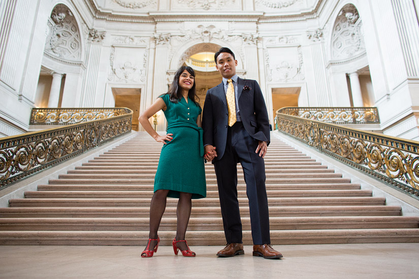san francisco city hall engagement photo of puja & john on the stairs