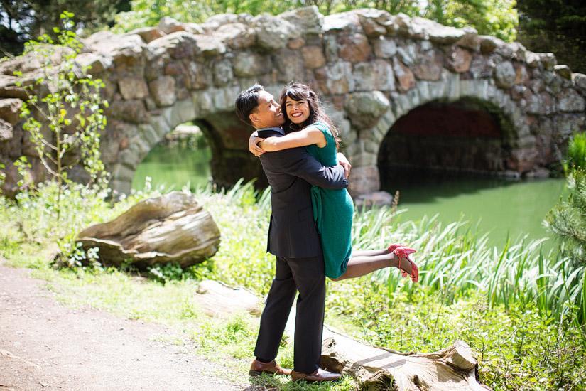 golden gate park engagement photo of john picking up puja