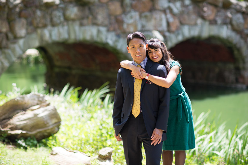 golden gate park engagement photo of puja & john cuddling