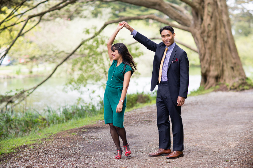 golden gate park engagement photo of puja & john dancing