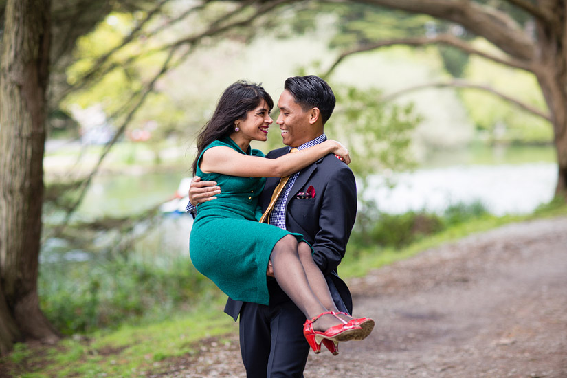 golden gate park engagement photo of john carrying puja