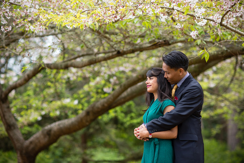 golden gate park engagement photos of puja & john cuddling