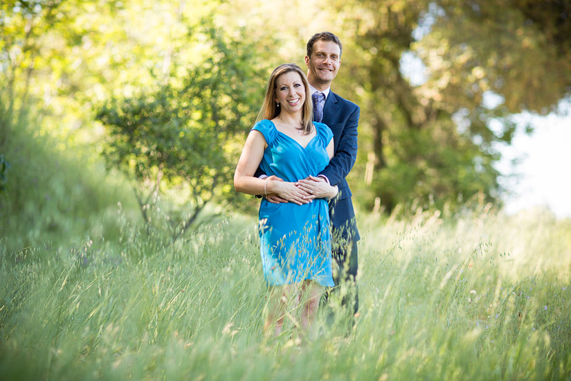 folsom engagement photo in a grassy field of erin and david hugging