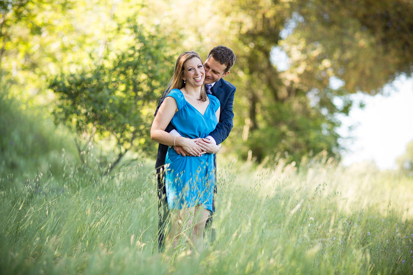 folsom engagement photos in a grassy field of erin and david hugging