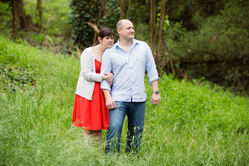golden gate park engagement photo of abby and craig in the tall grass