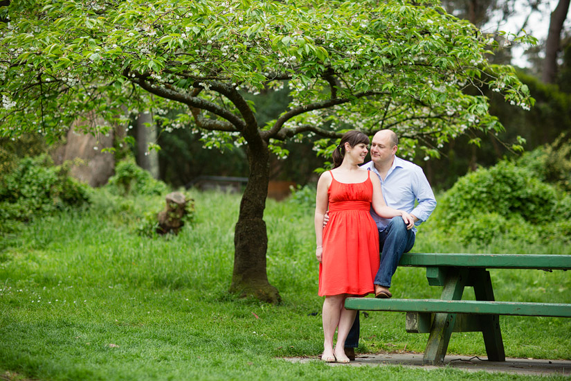 golden gate park engagement photos of abby and craig hugging