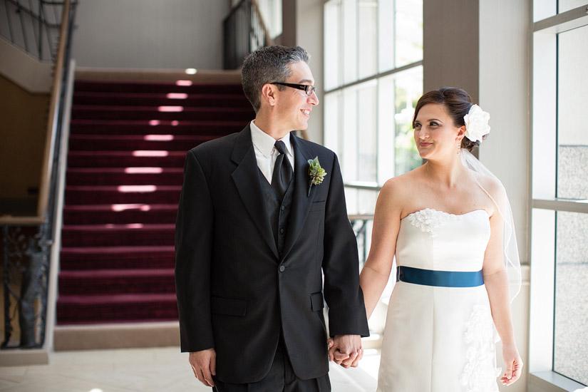 hyatt sacramento wedding, brenda & john holding hands