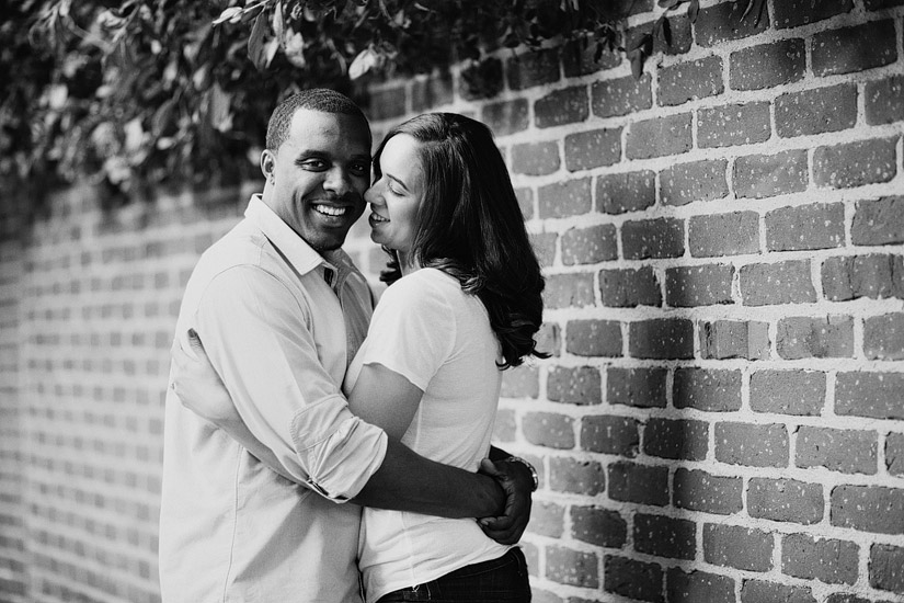 sacramento engagement photography of cassie and brandon by a brick wall