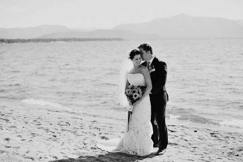 edgewood wedding photos of andrea & joe on the beach cuddling, lake tahoe