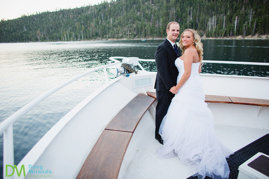 a-wedding-couple-on-the-bow-of-the-tahoe-psradise-boat-at-sunset