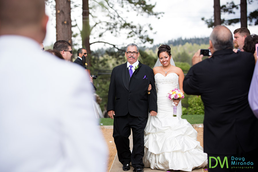theresa being walked down the aisle at her wedding by her dad