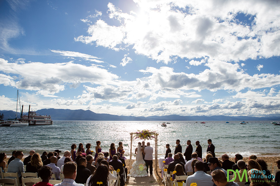 a beautiful view of a zephyr cove resort wedding this lake tahoe and clouds in the background