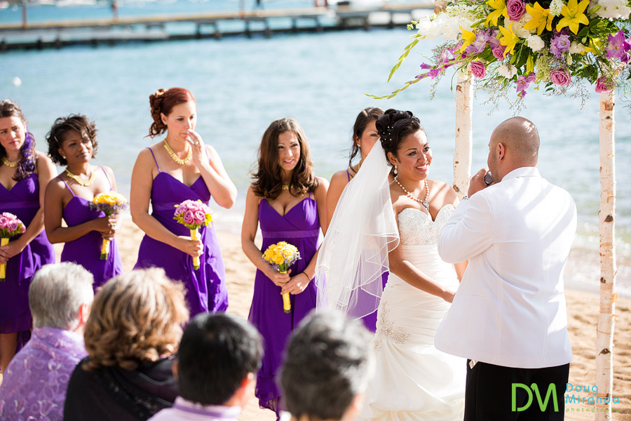 a bride and her bridesmaids all lined up during a lake tahoe wedding