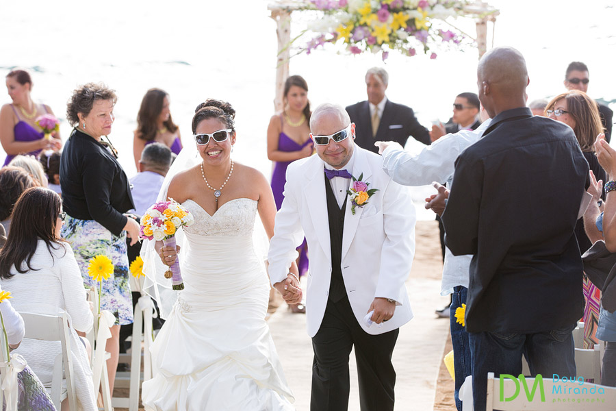 a wedding couple smiling as the walk back up the aisle after being married at zephyr cove