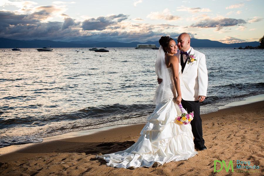 theresa & james on the sanding lake tahoe beach cuddling