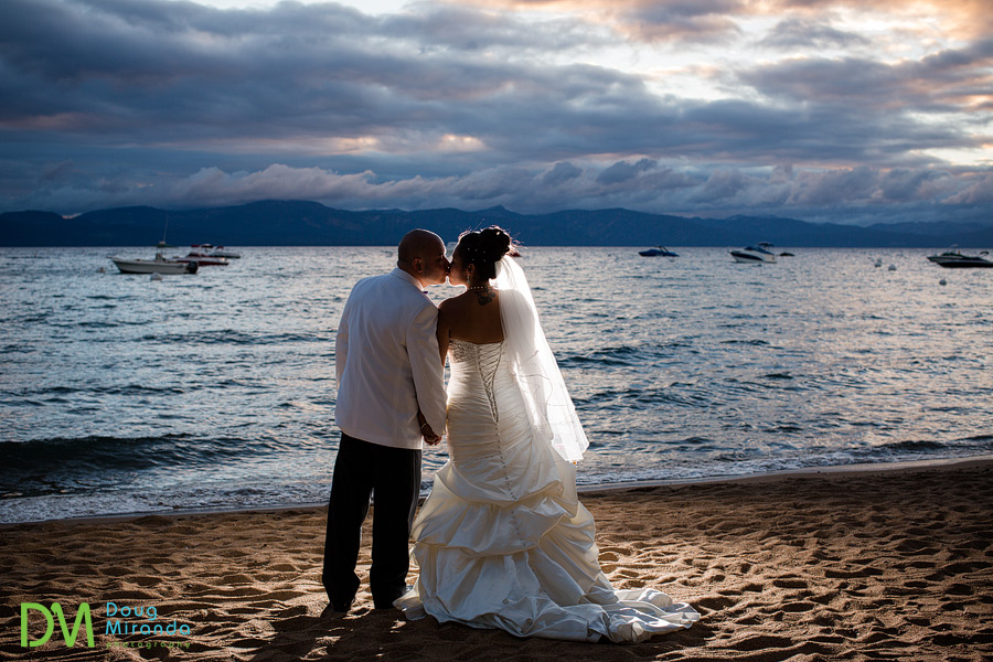 a wedding couple watching a beautiful lake tahoe sunset at zephyr cove resort