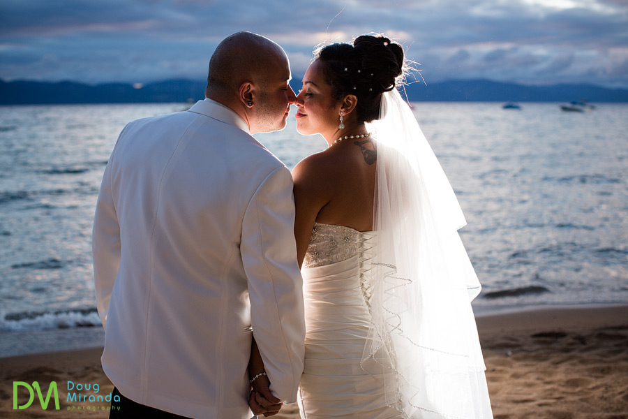 a wedding couple cuddling at sunset on lake tahoe