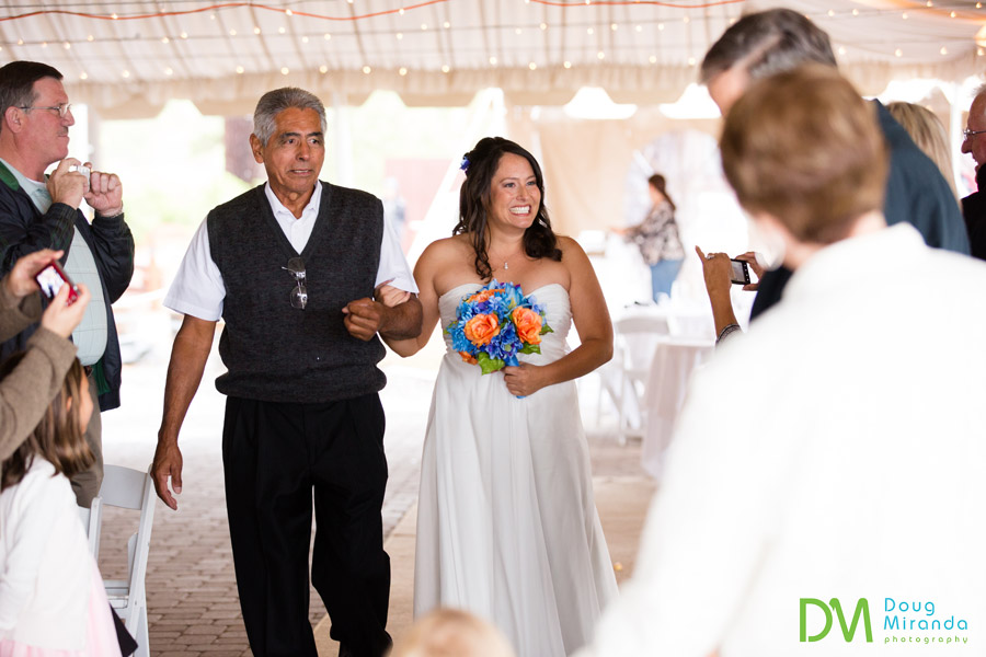 a smiling bride with her dad at her zephyr cove wedding