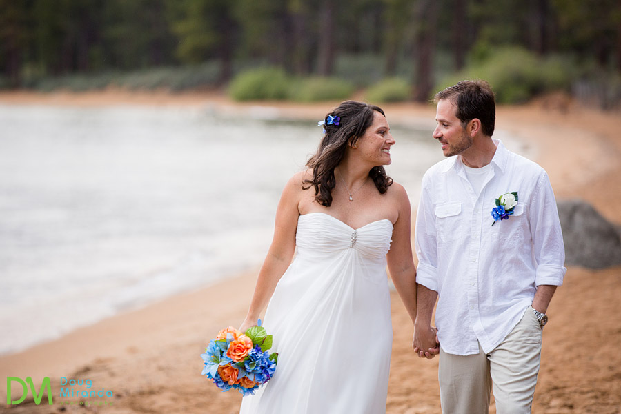 a zephyr cove resort wedding couple walking the beach at sunset