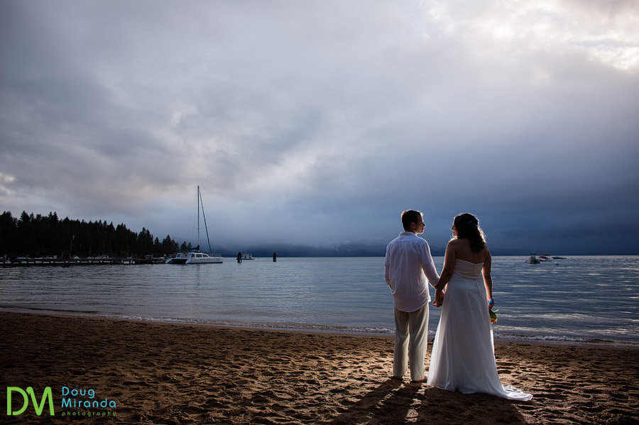 a zephyr cove resort wedding couple holding hands as a thunder storm approaches