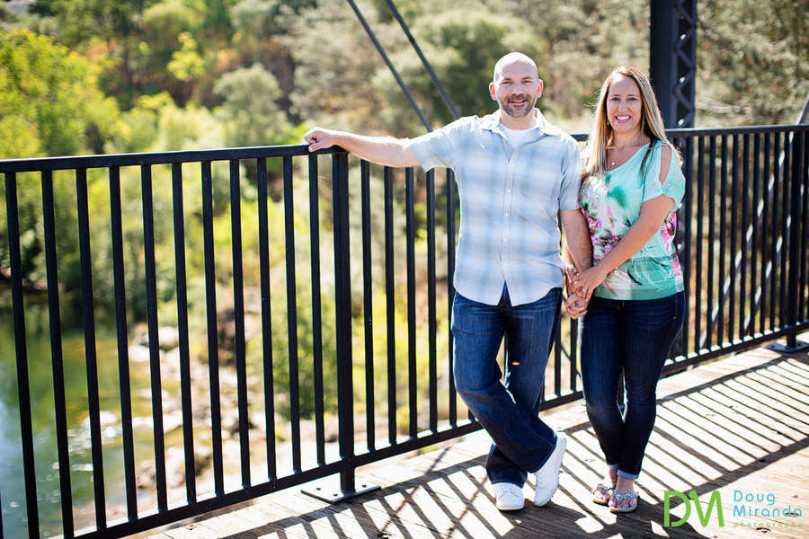 old folosom engagement photography of a couple holding hand on a old bridge