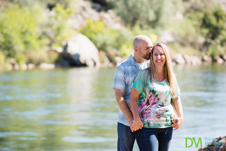 folsom lake engagement photos of alex kissing jessica by the waters edge