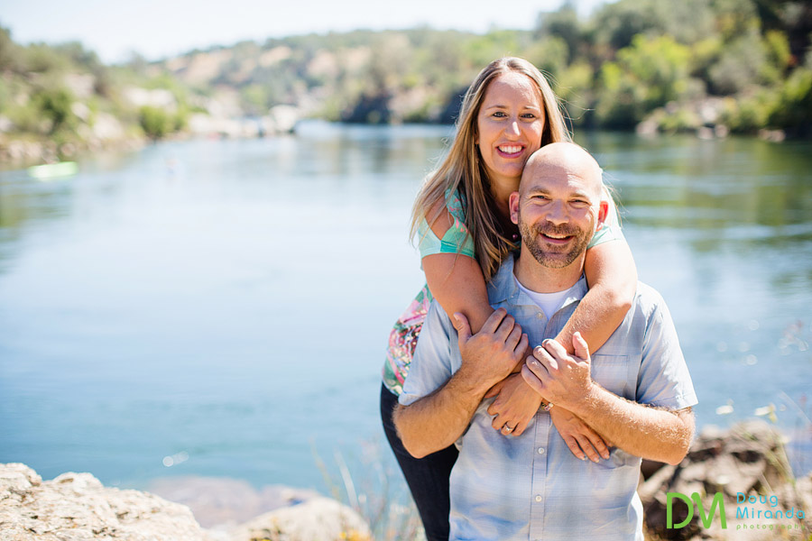 folsom engagement photos jessica hugging alex by lake natoma