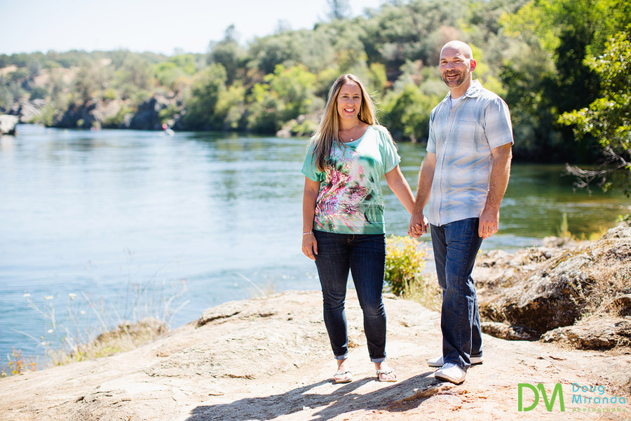 jessica and alex's folsom engagement photos holding hands by lake natoma