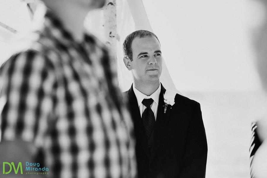 travis watching his bride walking down the aisle on their wedding day in lake tahoe