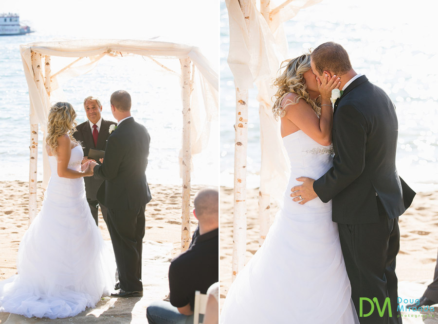 travis and kelsey kissing at the end of their wedding ceremony at zephyr cove resort