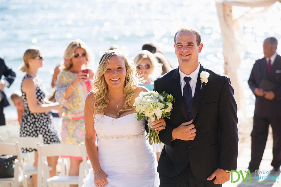 zephyr cove beach wedding photos of a couple walking back down the aisle