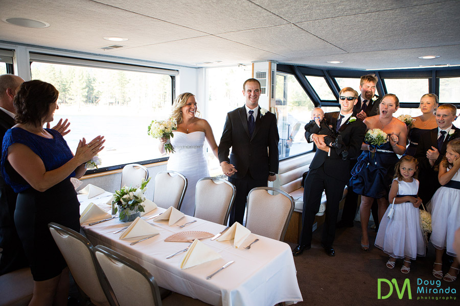 kelsey and travis being introduced at their tahoe paradise boat wedding