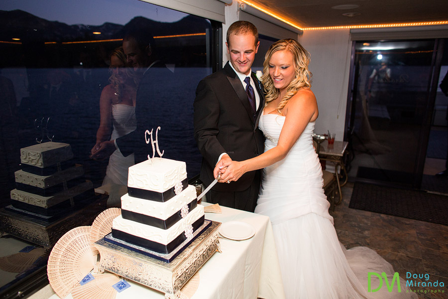 a couple cutting a wedding cake on the tahoe paradise boat