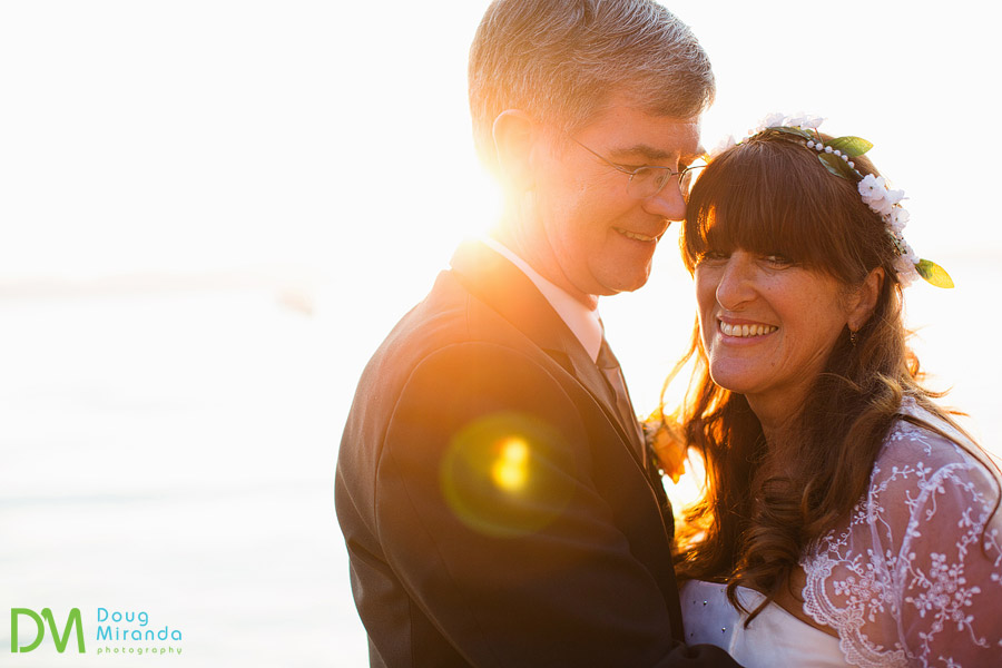 a cute couple laughing during their sunset wedding photos in lake tahoe