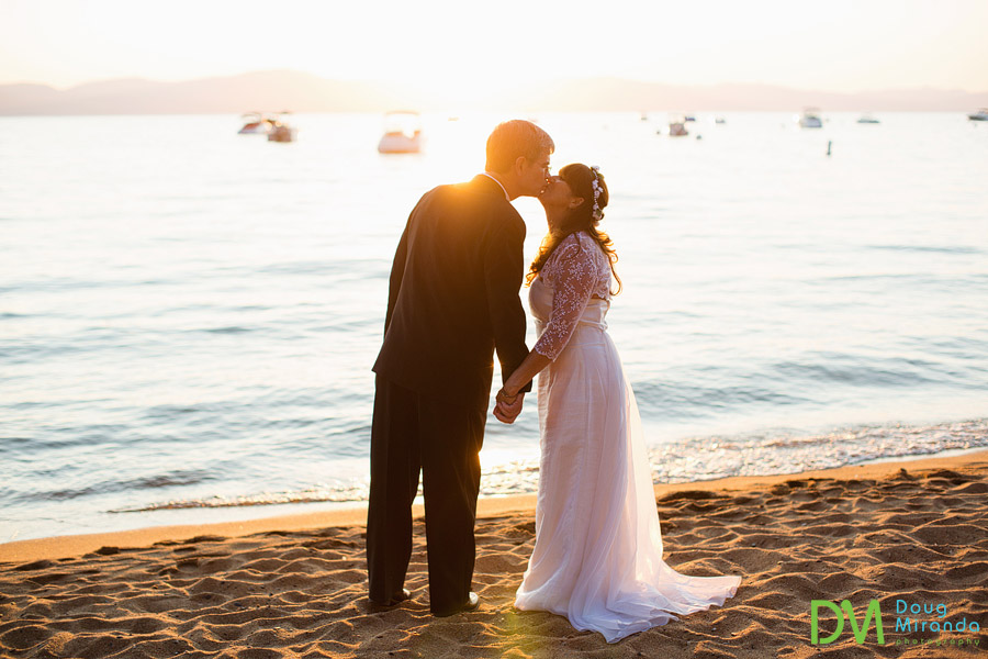 a couple wedding kissing at sunset at Zephyr Cove