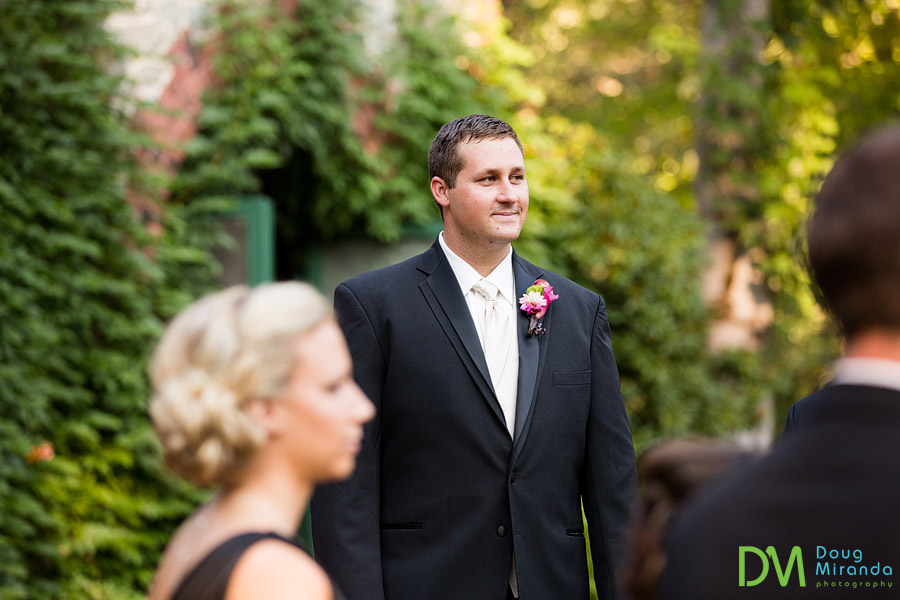 a groom waiting for his bride during the ceremony
