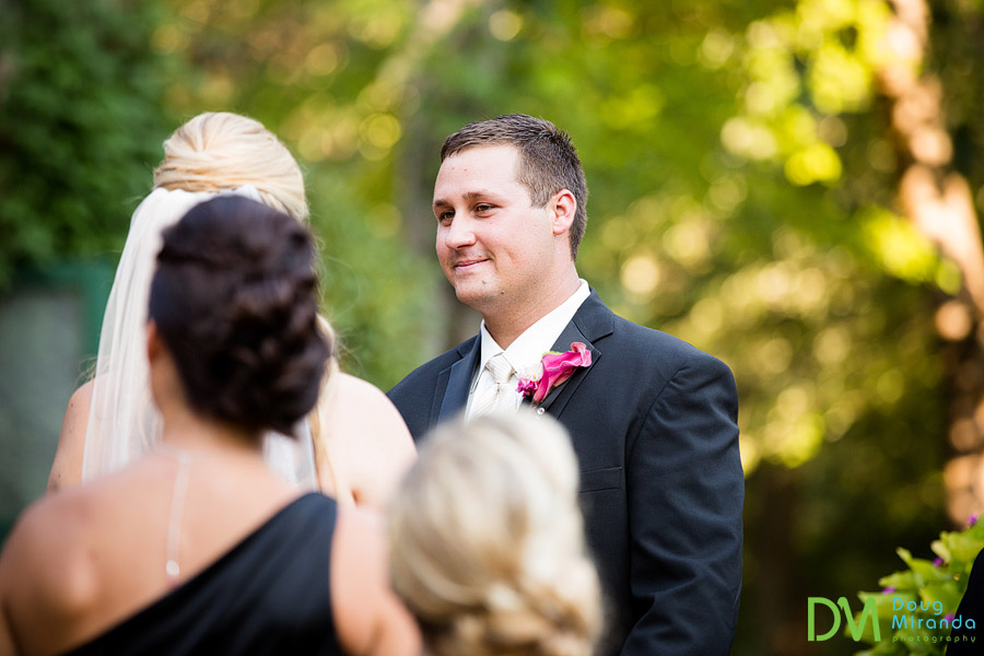 jerrid smiling at his bride during their ceremony