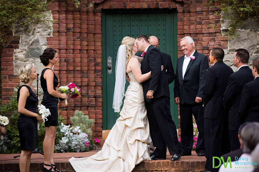 a couple kissing at the end of their grass valley wedding ceremony