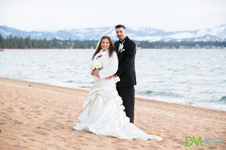 a wedding couple hugging on the beach at edgewood tahoe
