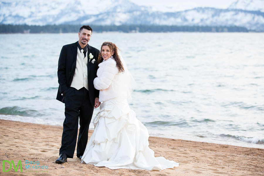 edgewood tahoe winter wedding photography of a couple on the beach