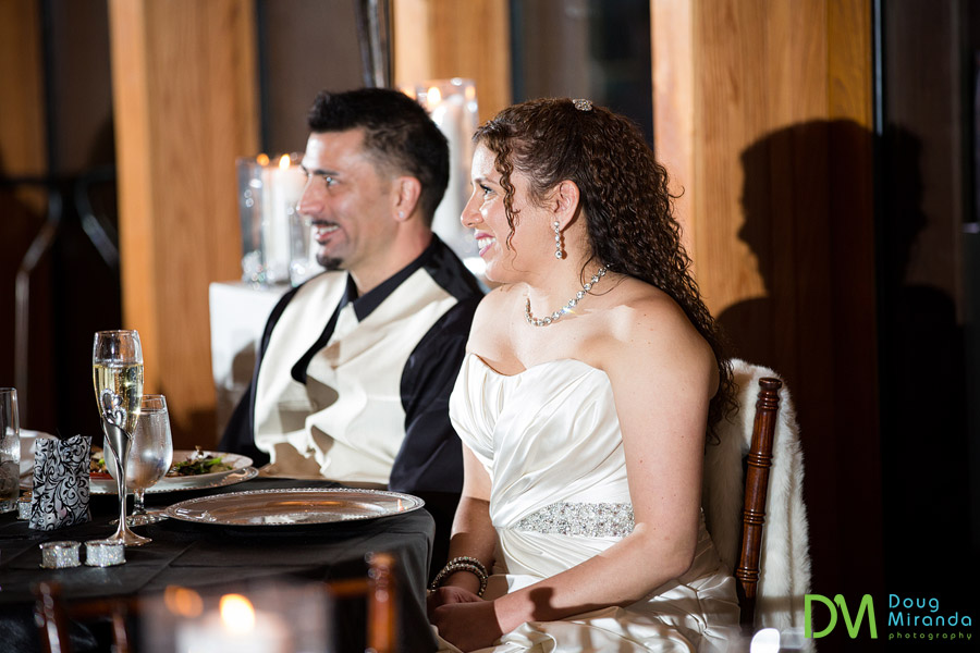 a smiling wedding couple at their tahoe wedding reception