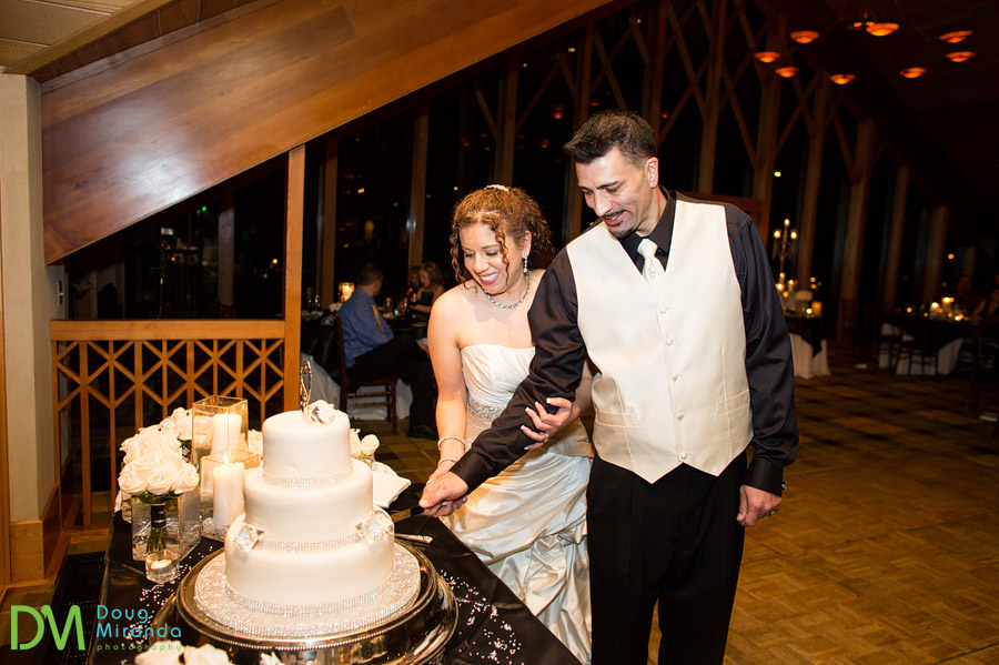 a couple cutting their wedding cake at edgewood tahoe
