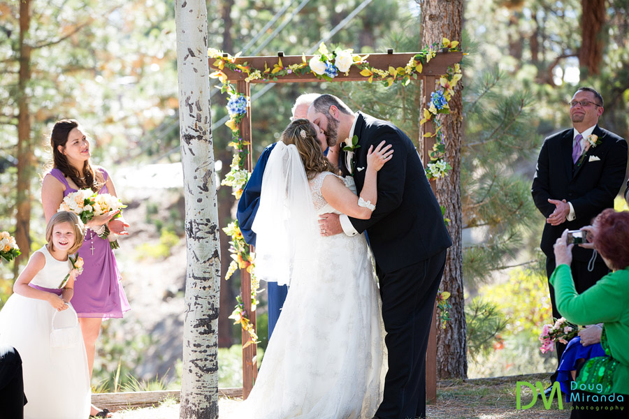 a bride and groom kissing at the end of their ceremony.